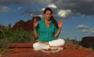 girl offering Reiki from Sedona red rocks